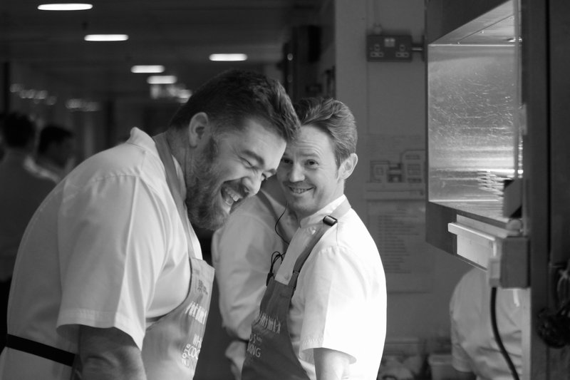 Nathan Outlaw laughing in the kitchen at Who's Cooking Dinner - a fundraising event for Leuka's leukaemia research