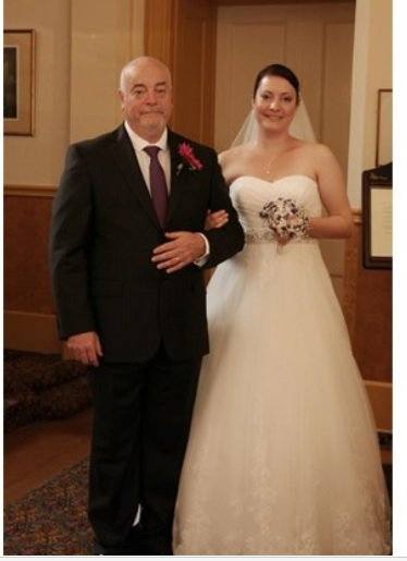 Laura Johnson and dad at her wedding