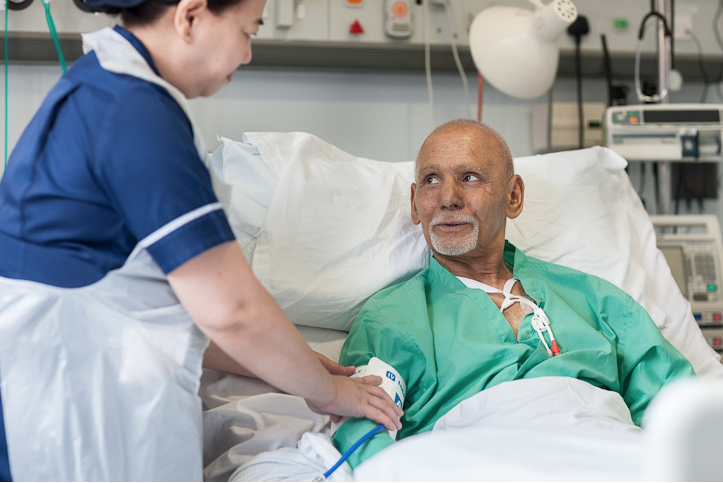 Leukaemia patient being cared for by nurse