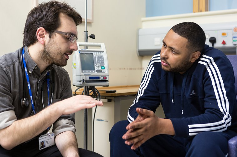 Doctor talks to a patient with leukaemia