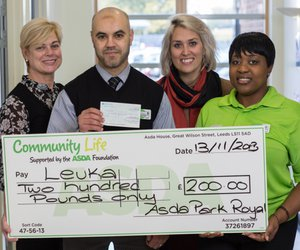 Leuka and Asda with giant cheque